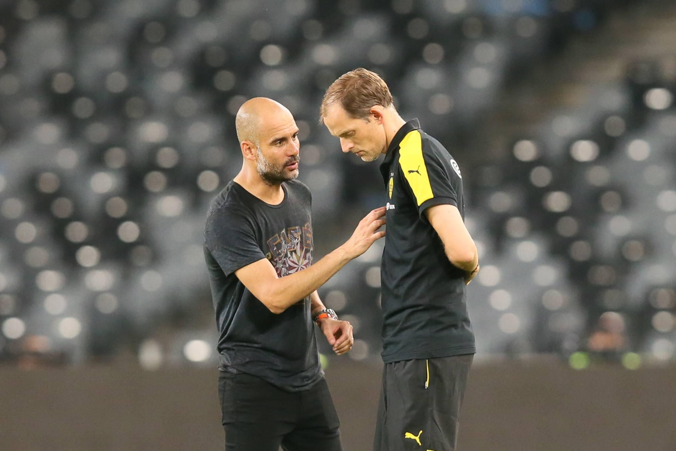 Pep Guardiola (ManCity) Tuchel (damals BVB, jetzt Chelsea) im Gespräch